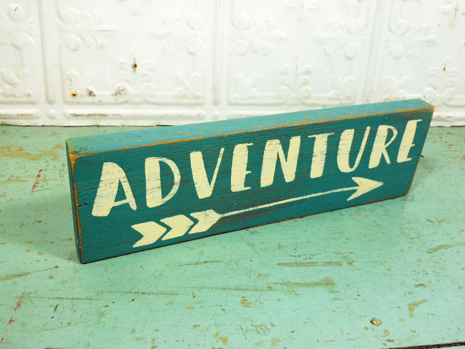 Adventure and Arrow on Reclaimed Wood