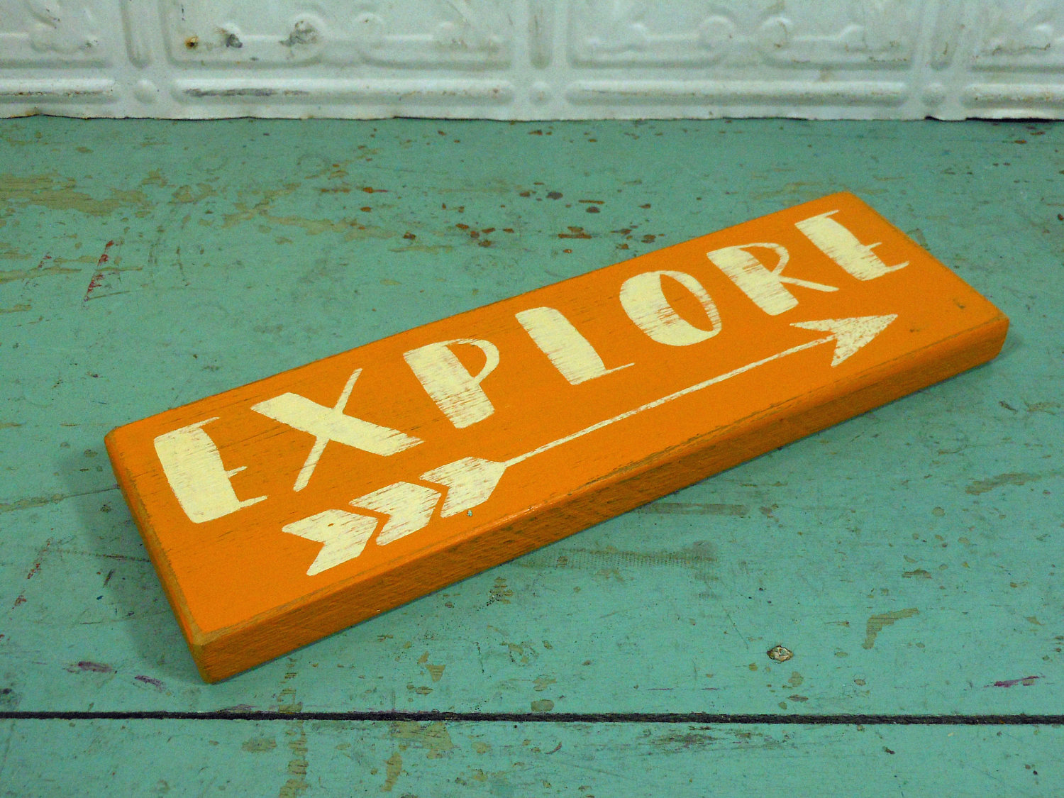 Explore and Arrow on Reclaimed Wood