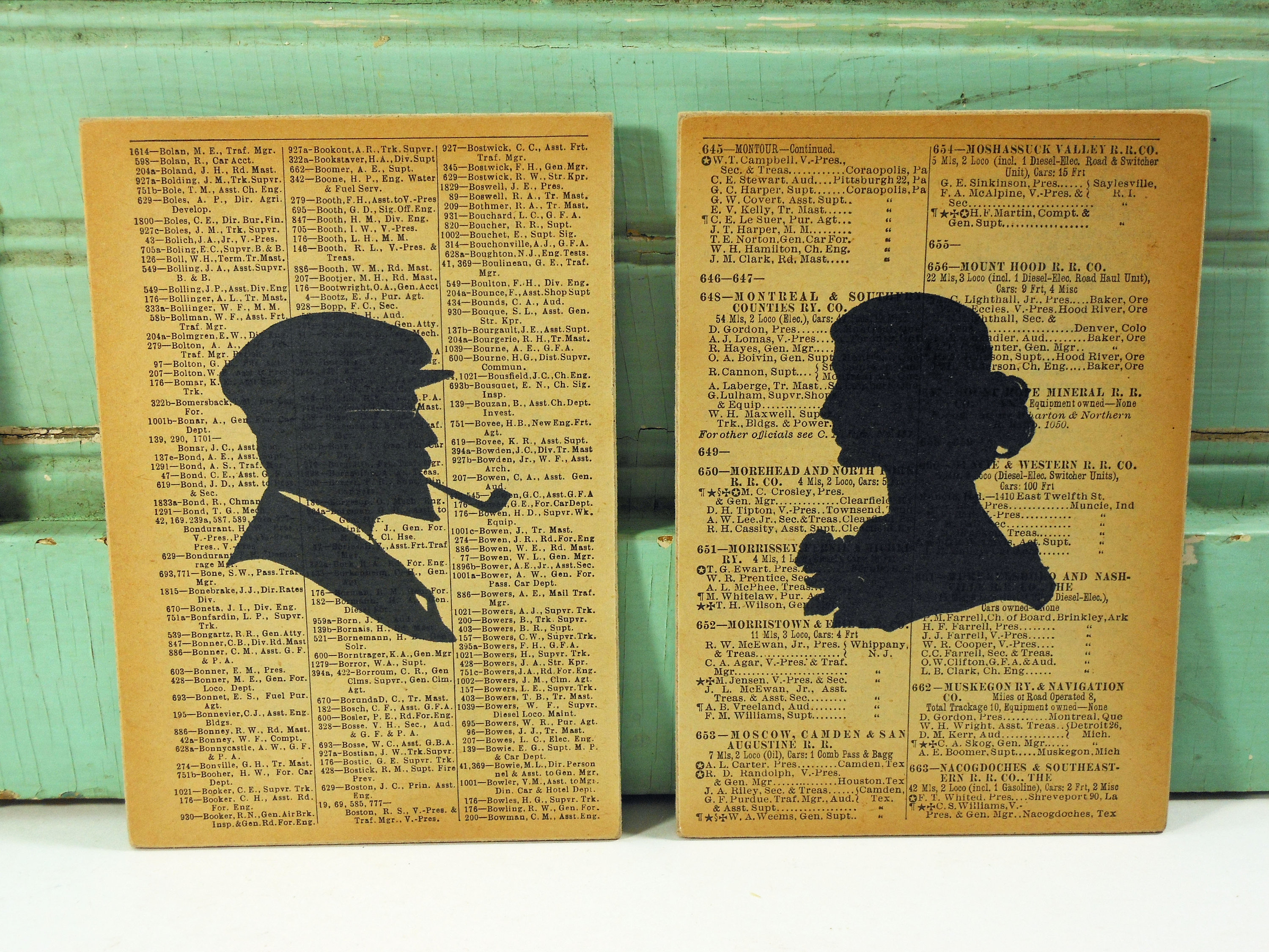 Pair of Silhouettes, Old Fashioned Man & Woman Prints on Pages from Vintage Railroad Book